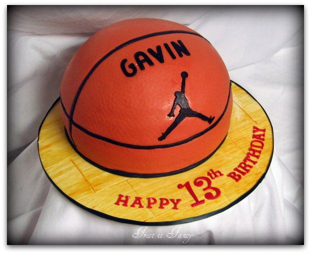 Basketball Cake  Cake was made for young man that likes Michael Jordan. So, the client had requested that his jumpman logo be on the cake.