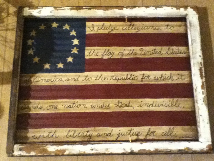 Flag painted on old barn tin and mounted in an old window frame.