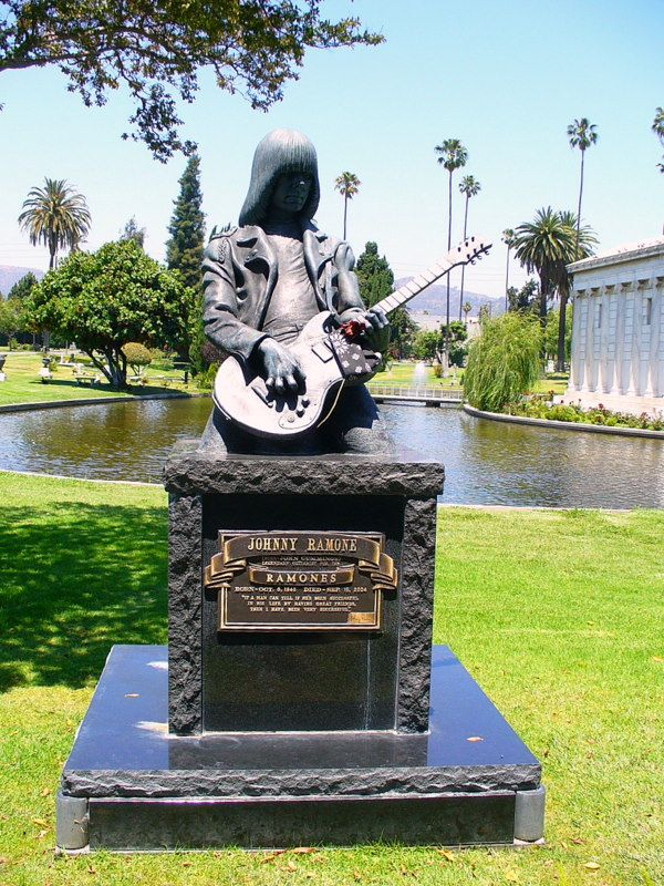 Dee Dee Ramone (1951-2002) and Johnny Ramone (1948-2004), founding members of the pioneering punk band The Ramones (1974-1996) are both immortalized at opposite ends of a small lake in the Garden of Legends section at Hollywood Forever Cemetery in Hollywood, CA.
