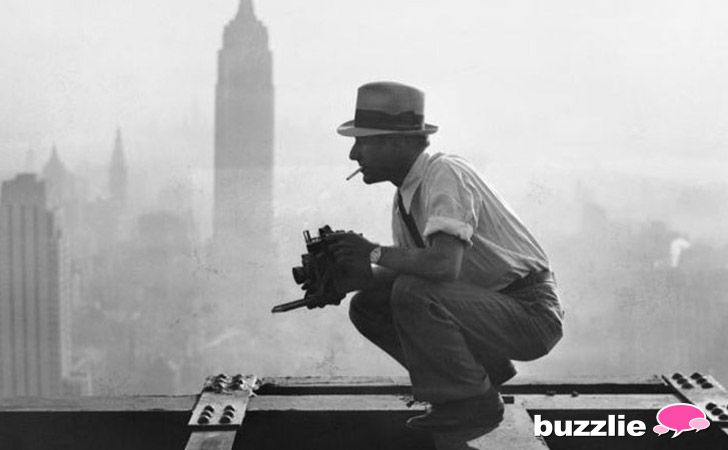 "This photographer's name was Charles Ebbets. He took his famous ""Lunch Atop A Skyscraper"" photograph just after this picture was taken, in 1932. Behind him you can see New York City as seen from the 69th floor of the GE building."