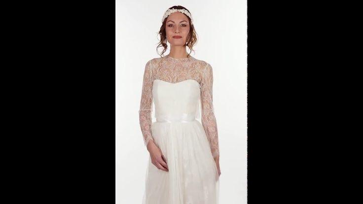 Accessoire pour robe de mariée. Boléro ras-du-cou en dentelle de Calais chantilly boutonné dans le dos avec boutons couverts de tulle. Manches longues. BO1A-690€ www.metalflaque.fr