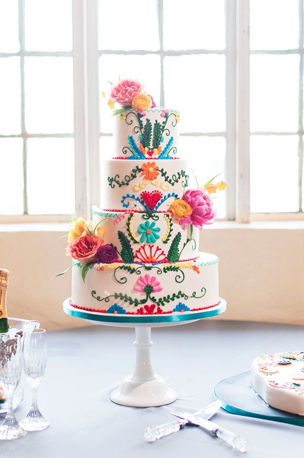 colorful festive wedding cake - photo by Ely Fair Photography http://ruffledblog.com/colorful-fiesta-wedding