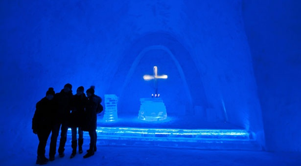 Visitors stand in a church built from snow in Mitterfirmiansreut, Germany.