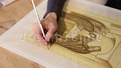 Iconographer painting - hand woman painting carefully icon.