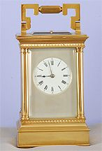 Antique French quarter hour petite sonnerie carriage clock in a  gilt and silver corinthian case with porcelain dial and repeat at will, circa 1885.