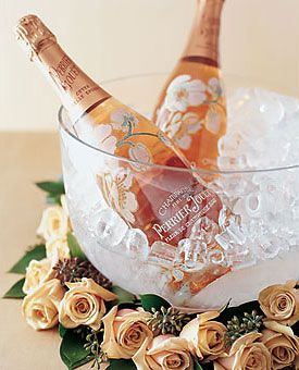 Make the champagne itself your table centerpiece with flowers around the base of an ice bucket.