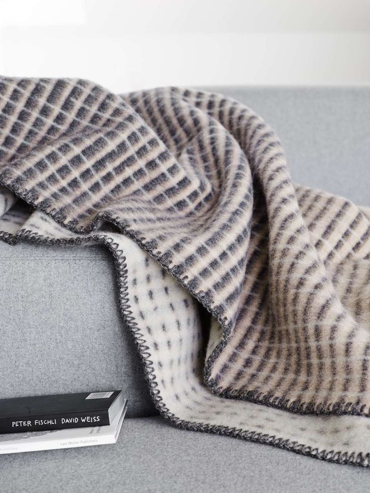 """""""Agnès"""" combines two moving rhythms. Along the horizontal, lines of graduated shades change colour; the vertical is dashed like rain. Get yours here: https://mallofnorway.com/gifts-home-decor/textile/blankets/blanket-agnes-grey?no_size=1"""