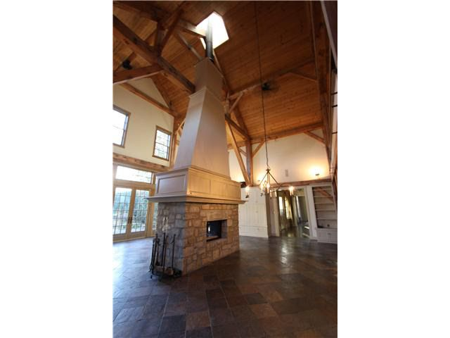 Barn house exposed beams double sided fireplace