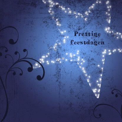Sfeervolle kerstkaart met ster bestaande uit lichtjes op een blauwe grunge achtergrond. In donkerblauw sierlijke lijnen. Pas de tekst naar wens aan.