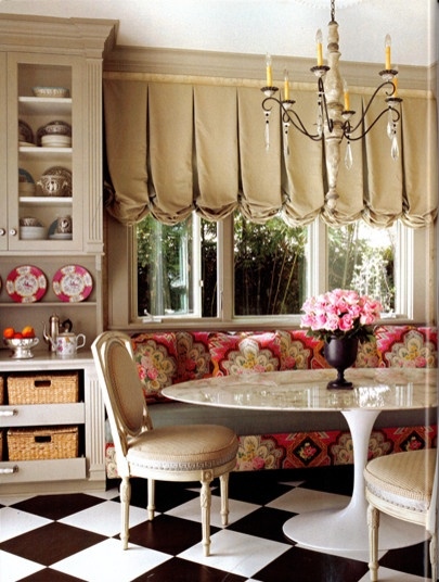 love the bold black and white checkerboard floor and bold rosey floral fabric in this cute breakfast nook / banquette