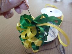 Per request, the following includes a little more information on how to make a two-color version of the puffy ribbon lei .   First, tie an a...