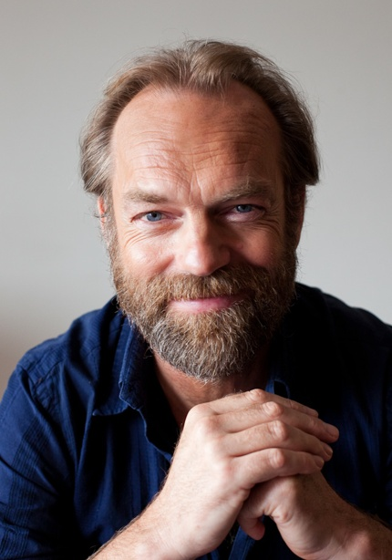 """Hugo Wallace Weaving (born 4 April 1960) is a British-Australian film and stage actor. He is best known for his roles as Agent Smith in the Matrix trilogy, Elrond in the Lord of the Rings trilogy, """"V"""" in V for Vendetta, and performances in numerous Australian character dramas ."""