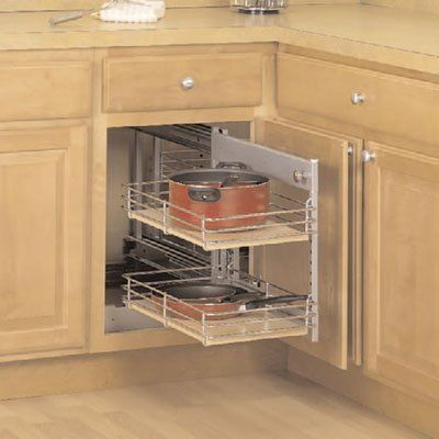 KV slide out base blind corner unit, in a frosted nickel finish. Turns  wasted cabinet corner interior into premium
