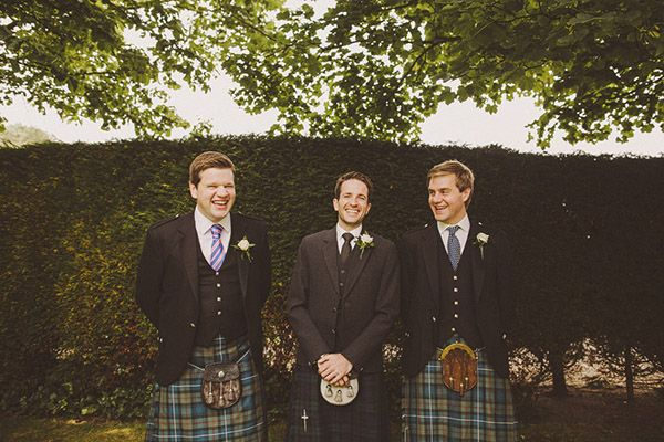 Traditional kilts for the groom and his groomsmen at this destination wedding in Scotland. | Photo: Ed Peers | Via Snippet & Ink