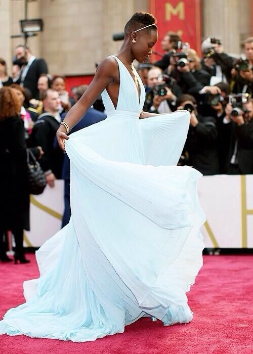 Lupita in a gorgeous shade of blue
