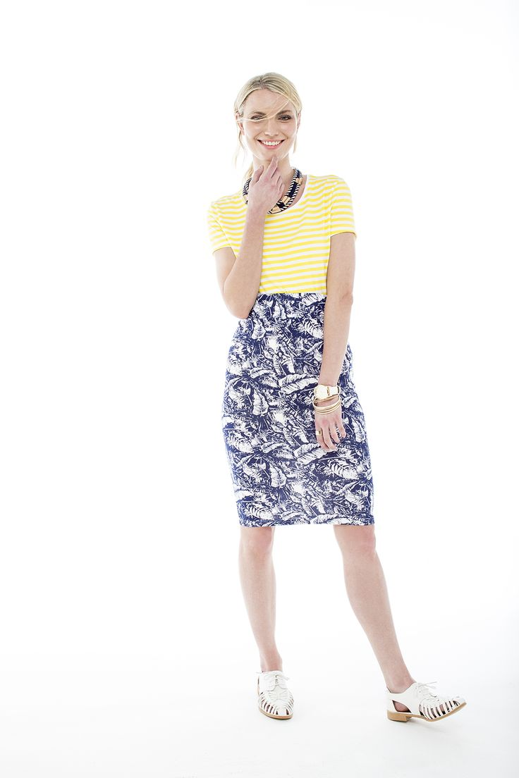 Ever so cute striped yellow top worn with a printed tube skirt.