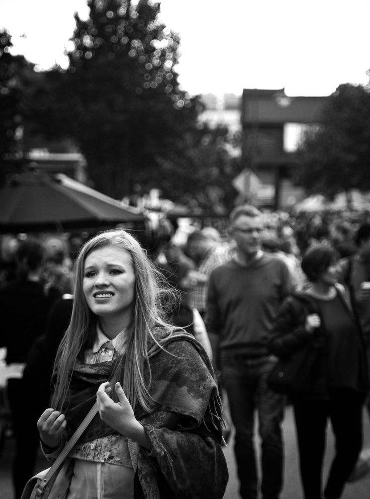 Potential final #10: Wasn't happy with the colour version of this image so I have cropped it and tried it in black and white, I like this much better, I like the composition a lot better now and I think it makes you look at the girl first and then the crowd behind her.