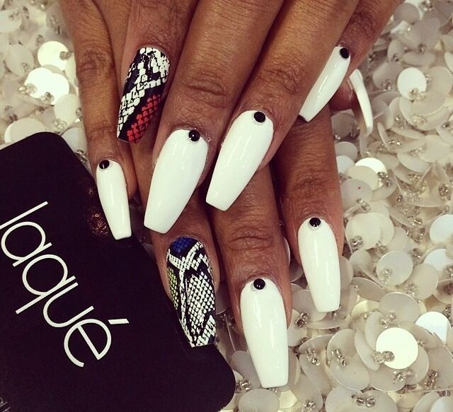Snake skin ish nails with black rhinestone. White nail polish, Killer