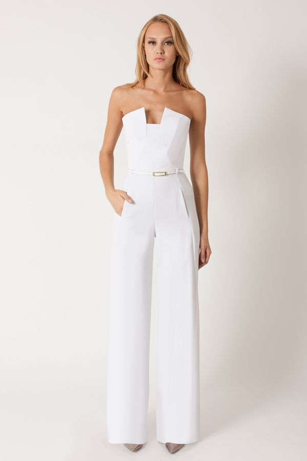 "Black Halo - Lena Jumpsuit - White White | Our sleek stretch gabardine strapless jumpsuit, with strategic seaming at center front and center back panel to add a slimming effect. Jumpsuit has rectangular cut out at center front neck, seaming and boning throughout the bodice, and pockets at hips. Purchase includes 3/8"" genuine leather belt and has a center back invisible zipper. Jumpsuit has a 35"" inseam."