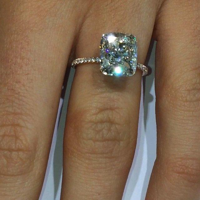 Emerald cushion cut diamond with rose gold setting. More