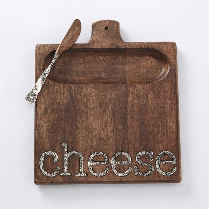 2-piece set. Mango wood board features cast aluminum 'cheese' inset sentiment and cracker well. Arrives with cast aluminum handled spreader with mango wood blade.