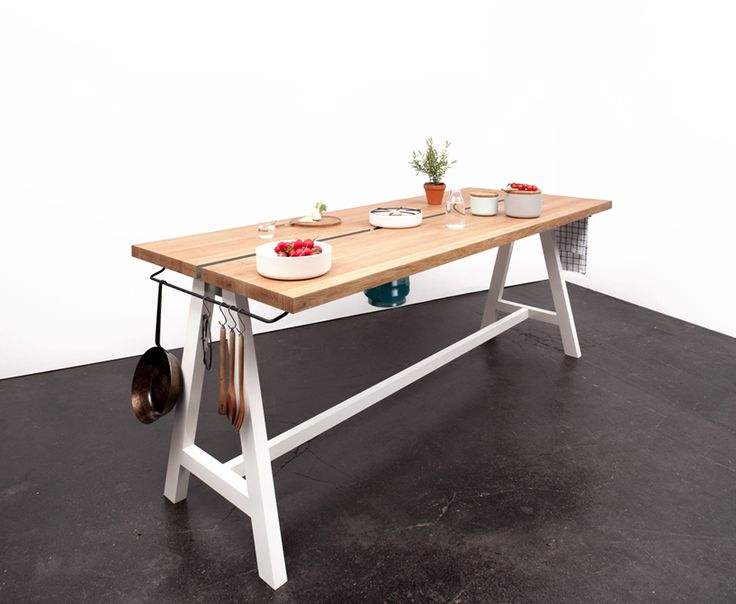 mortiz putzier's rethinks the traditional kitchen with cooking table