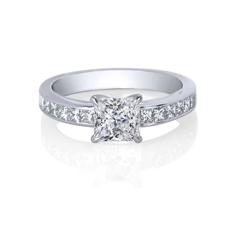 Modern simplicity, this Art- Deco inspired Amira Design is enhanced by an exquisite band of dazzling, channel set, princess-cut diamonds.