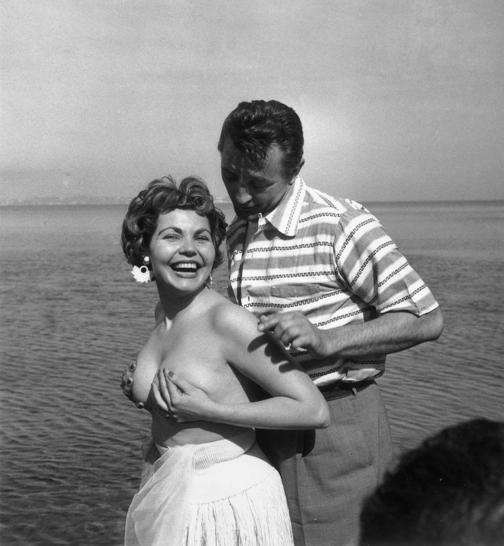 Simone Silva and Robert Mitchum, 1954 When Simone Silva posed topless at Cannes, she inspired a melee where one photographer broke his arm and another broke his leg. She was later asked to leave the festival.