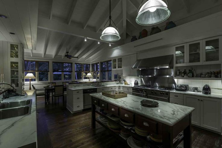 Nice layout for a large kitchen.  Island space for everyday plates.  Mix of open, glassed in and closed cupboards.