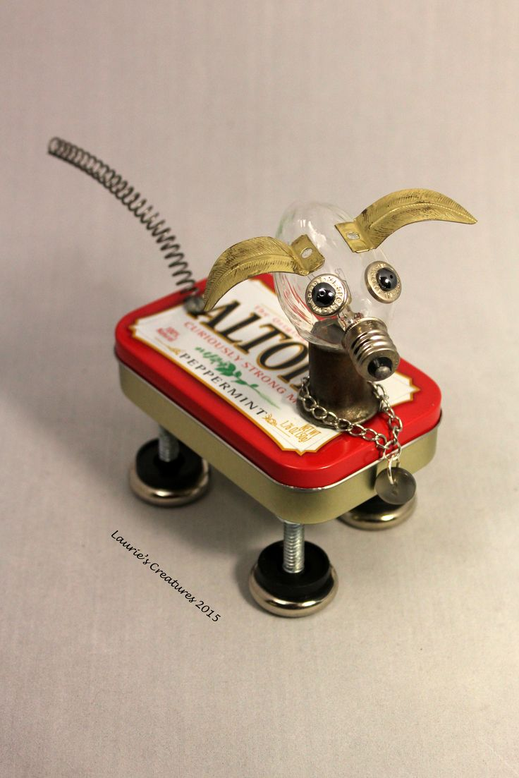 """""""Sport"""" ~  Found object/junk art created by Laurie Schnurer in 2015. You can open the Altoid tin to store small items inside."""