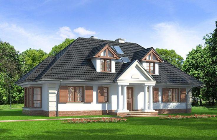Dom jednorodzinny, parterowy z poddaszem użytkowym w stylu dworkowym.