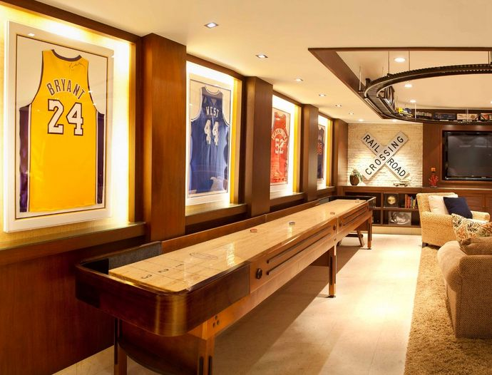 Need an area for a shuffle board!! love the jerseys on the wall!