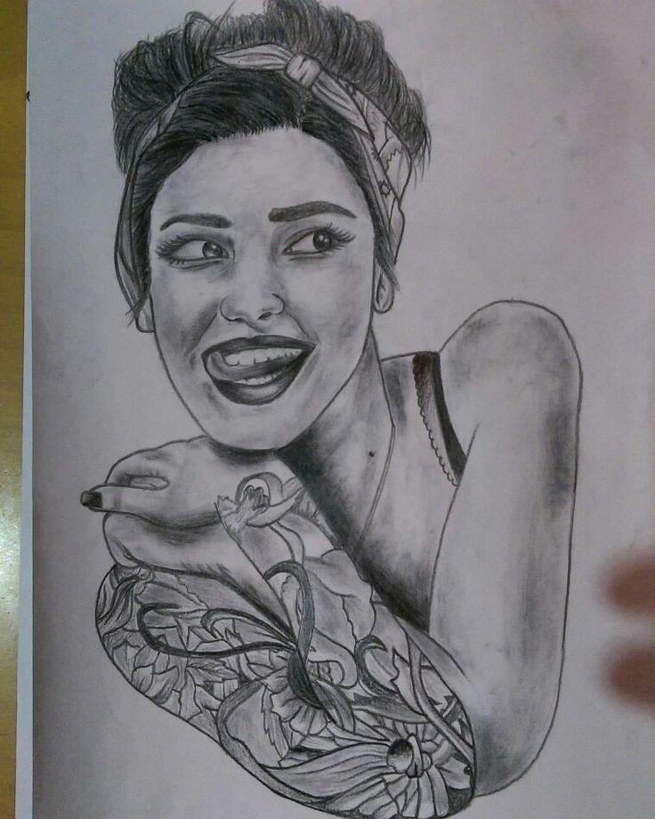 Tattooed girl drawing