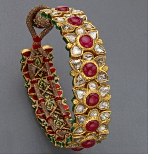 Gold kada studded with uncuts and rubies