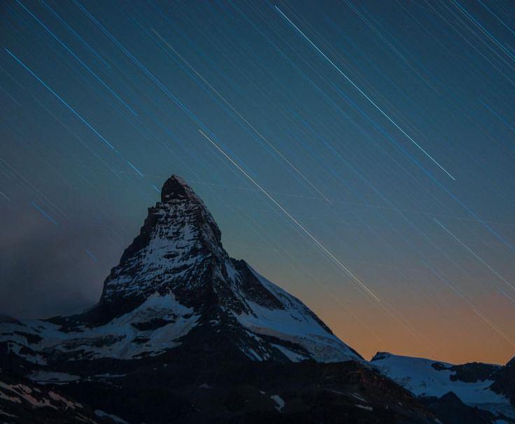 "427.7k Likes, 1,328 Comments - National Geographic (@natgeo) on Instagram: ""Photo @ladzinski / Stars, streaking from a long exposure over Switzerland's iconic #matterhorn…"""