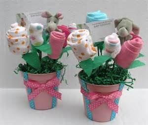 here are some baby pots decked up in pink and blue ribbons with baby ...