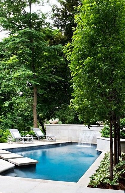 This is pretty pool would be right at home in the Hamptons