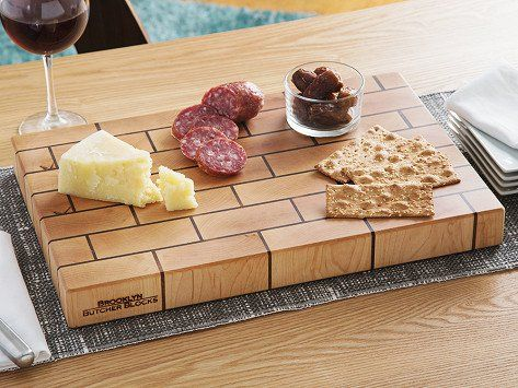 This Made in the USA, end-grain butcher board was built beautifully, and built to last. It draws cues from the brownstones of Brooklyn, with a staggered stacking block design (like a real brick wall) for the strongest bond possible. Each board will age gracefully and stand the test of time.