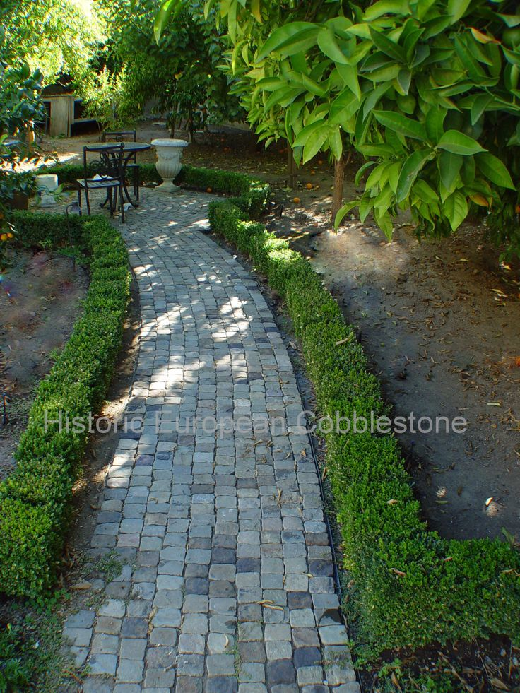 Reclaimed antique cobblestone for garden path leading to dining area! So inviting!