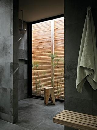 I love bluestone! Studio Moore...The bluestone flooring continues into the bathroom areas.