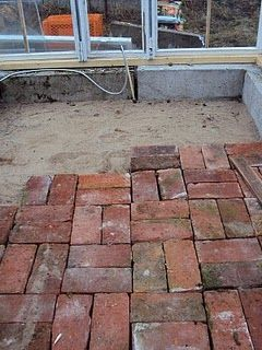 [This, with recycled rubber bricks, on top of the old garage pad, warmer and softer]