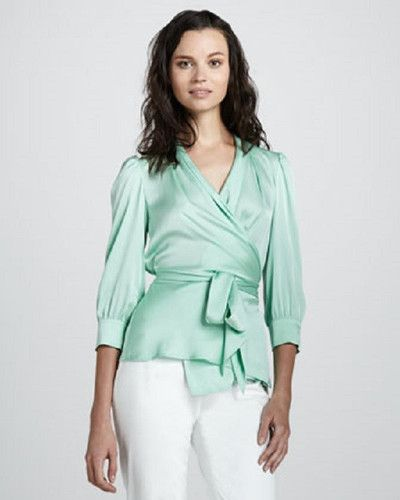 Catherine Malandrino Silky Wrap Blouse Pastel Mint Green for $120.00. Escape the doldrums of the everyday corporate trope in a striking Catherine silk charmeuse blouse. Catherine Maladrino's  delightful pastel blouse has a smooth luxurious feel. Can be worn skirts, pants and jeans with aplomb.