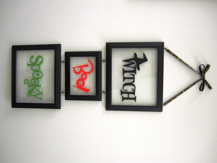 Halloween hanging frames -- loving the concept ... damn I need a cricut!!