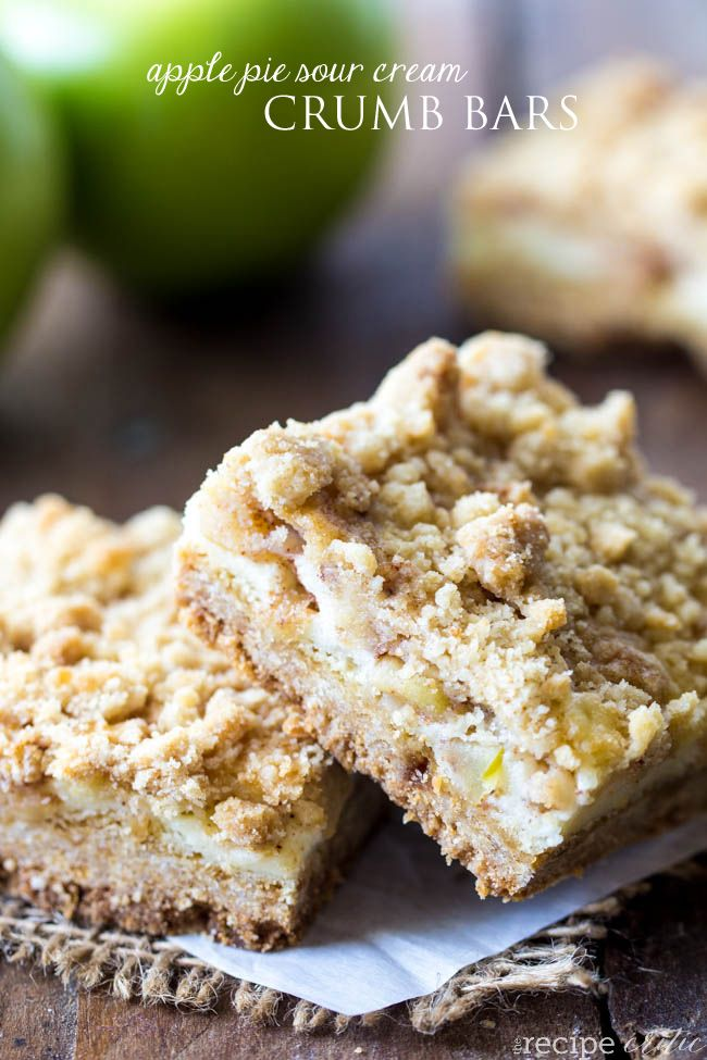 Apple Pie Sour Cream Crumb Bars at http://therecipecritic.com The BEST crumb bar recipe with a sweet and cream sour cream center and fresh apples packed inside!