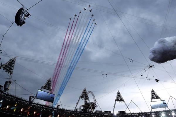 The Red Arrows fly over Olympic Stadium before the Opening Ceremony at the 2012 Summer Olympics, Friday, July 27, 2012, in London.