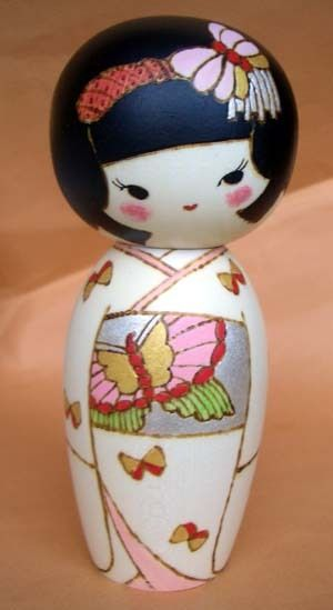 I collect kokeshi dolls - need one with a butterfly on it :) (oki Izumi)