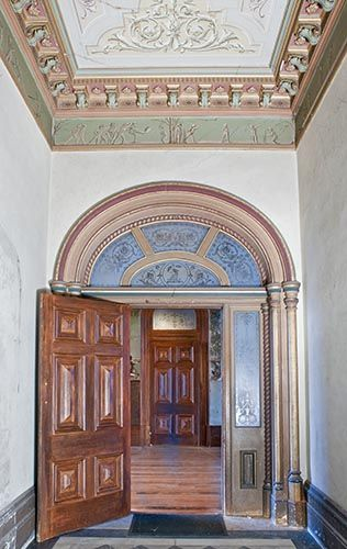 Entrance hall towards the vestibule, Villa Alba, Kew, Melbourne, showing the frieze of 'putti' playing football and cricket