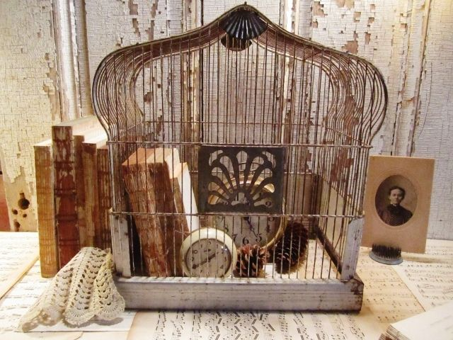 Bird cage decoration using old books, old clock and pinecones!  Find them at Family Tree Vintage to recreate a similar look!   www.tracyfowler.com