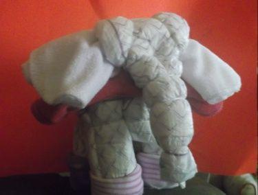 diaper elephant socks, wash cloths, bib, and diapers; diaper cake; diaper animal; baby shower $10