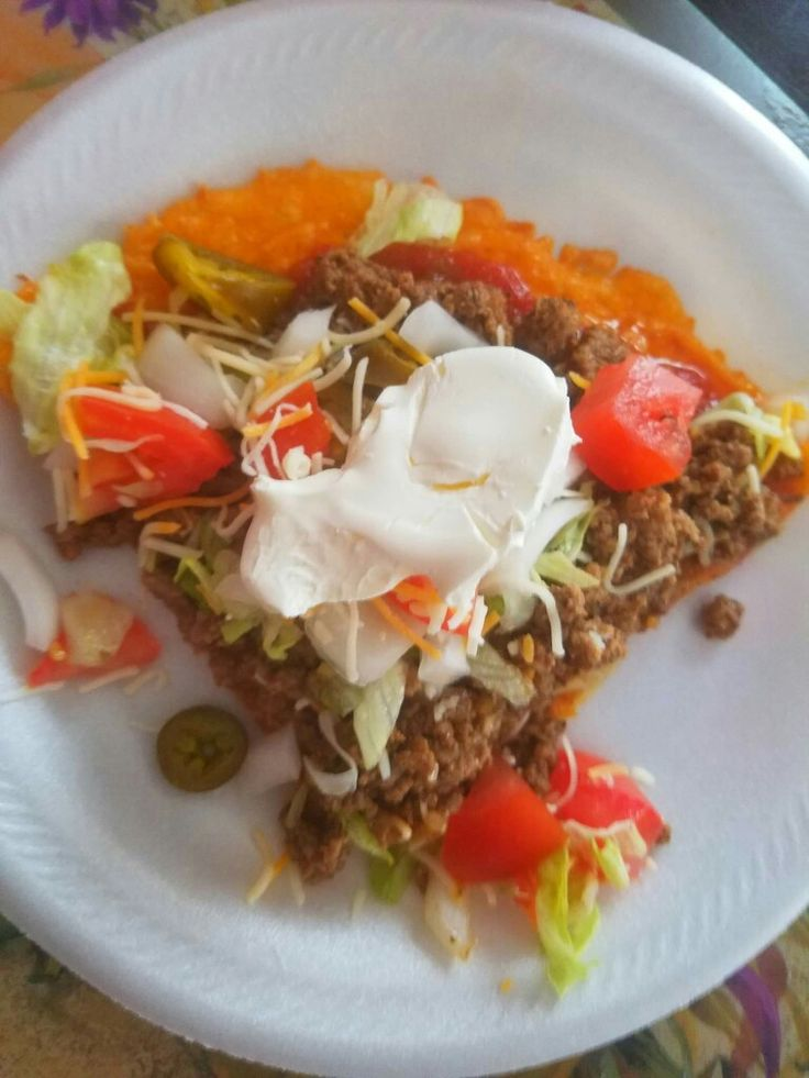 Taco pizza.  Crust: 3/4 cup Mexican cheese,  1/4 cup cheddar cheese.  Mix well. Press flat on to a pizza pan lined with parchment paper. Bake in the oven for 15 minutes on 325.  Taco meat: 1 lb of hamburger  1 tsp cumin  1 tsp garlic powder  Salt and pepper to taste. Brown hamburger and seasonings until no longer pink.   Top the cheese crust, layering with salsa first, followed by hamburger and your choice of toppings.